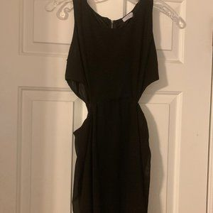 Black fitted dress with side cutouts